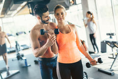 Personal trainer helping Stock Image