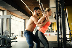 Personal trainer helping. Women in gym Royalty Free Stock Images