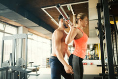 Personal trainer helping. Women in gym Stock Photos