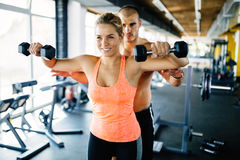 Personal trainer helping. Women in gym Royalty Free Stock Photography