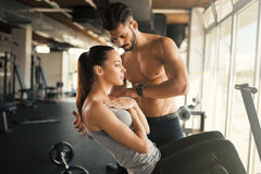 Personal trainer helping. Women in gym Royalty Free Stock Photo
