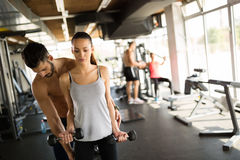 Personal trainer helping. Women in gym Stock Photo