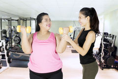Personal trainer and her client with dumbbells Royalty Free Stock Photo