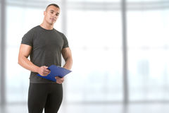 Personal Trainer Holding a Pad Stock Photography