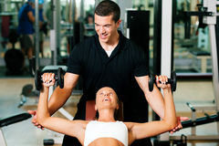 Personal Trainer In Gym Stock Images