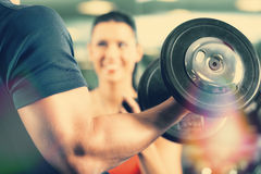 Free Personal Trainer In Gym And Dumbbell Training Royalty Free Stock Images - 49480859