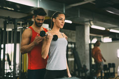 Personal trainer instructing trainee Stock Images