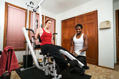 Personal Trainer Instruction. A personal trainer gives instruction on weight lifting Royalty Free Stock Photos