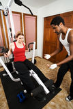Personal Trainer Instruction. Personal trainer encourages his client/student to lift Stock Images