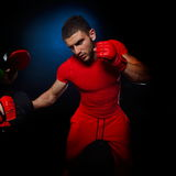 Personal trainer man coach and man exercising boxing Stock Photography