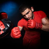 Personal trainer man coach and man exercising boxing Stock Image