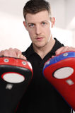 Personal Trainer with pads royalty free stock images