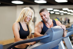 Personal trainer set difficulty on treadmill for woman Royalty Free Stock Image