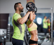 Personal trainer at shoulder workout Royalty Free Stock Photos