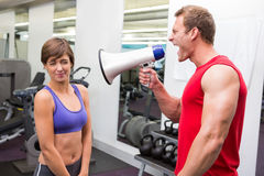 Personal trainer shouting at client through megaphone Stock Photos