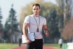 Personal Trainer Showing Thumbs Up Sign Stock Image