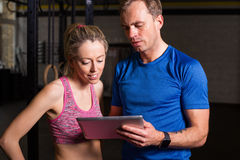 Personal trainer showing woman workout plan Stock Photos