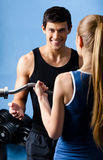 Personal trainer shows woman the correct exercise performing Stock Photography