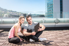 Personal trainer sitting with his client Royalty Free Stock Images