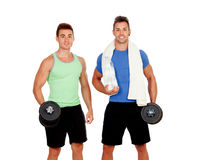 Personal trainer  and strong boy with dumbbels Royalty Free Stock Image
