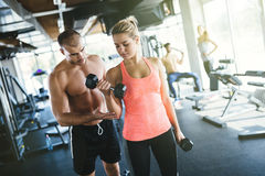 Personal trainer and student in gym Royalty Free Stock Photos