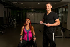 Personal Trainer Take Notes Stock Images