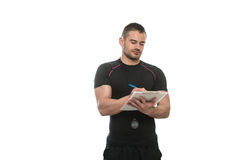 Personal Trainer Takes Notes On Clipboard White Background Royalty Free Stock Image