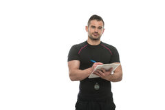 Personal Trainer Takes Notes On Clipboard White Background Stock Images