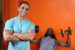 Personal trainer and trainee. At the gym Royalty Free Stock Image