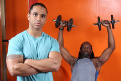 Personal trainer and trainee. At the gym Stock Images