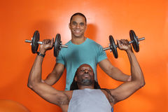 Personal trainer and trainee. At the gym Royalty Free Stock Photos