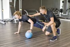 Personal trainer and trainee stock photos