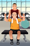 Personal trainer training an elderly man Royalty Free Stock Photos