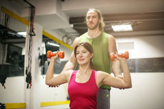 Personal trainer training his client in the gym. Shot of a Royalty Free Stock Photo