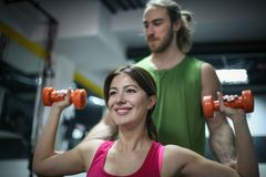 Personal trainer training his client in the gym. A shot of a personal trainer training his client in the gym Stock Photo