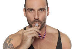 Personal Trainer, with a whistle in his hand Royalty Free Stock Photos