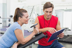 Personal trainer working with client holding dumbbell Royalty Free Stock Photography