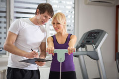 Personal trainer working with his client Stock Photo