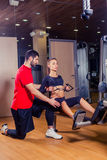 Personal trainer working with his client in gym Royalty Free Stock Image