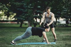 Personal trainer working with his client outdoors royalty free stock photo