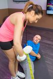 Personal trainer working with senior man using strap. Personal trainer working with senior men using strap personal royalty free stock photo
