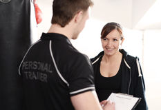 Personal Trainer writing training notes Stock Photo