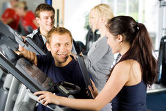 Personal trainers giving instruction Stock Image