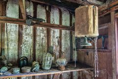 Treasures hidden in the corner of a Barn. Personal treasures hidden away on dusty weathered shelves covered with cobwebs royalty free stock image