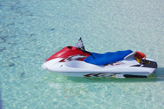 Personal Watercraft. Parked on crystal blue water royalty free stock photo