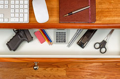 Personal weapon in work desk Royalty Free Stock Image