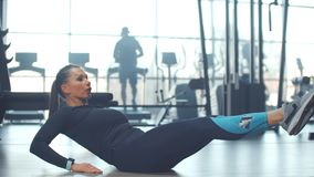 Personal workout on the abdominal muscles in the gym