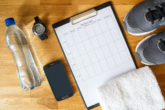 Personal workout plan with phone and other stuff stock photography