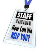 Personale - come possiamo vi aiutiamo - cordicella e distintivo Fotografie Stock Libere da Diritti