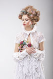 Personality. Luxurious Woman with Flowers in Evening Costume. Luxurious Woman with Flowers in Evening Costume royalty free stock images